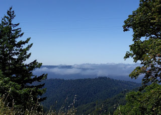 Fog rolling in over the coastal hills as viewed from Skyline Boulevard, Los Gatos, California
