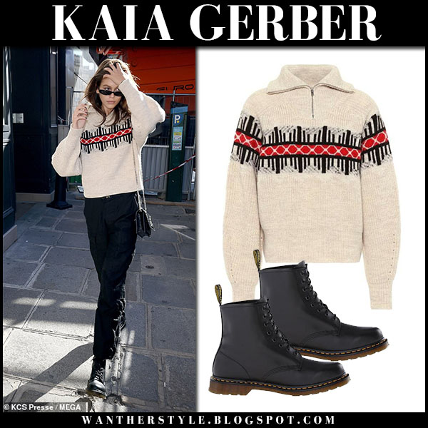 Kaia Gerber in beige knit sweater, black pants and black boots dr. martens fashion week outfits september 25