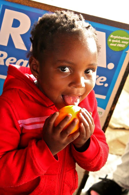 South African child licking citrus
