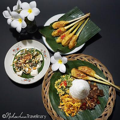 a set menu consist of nasi campur and veggies sambal mbe with sate lilit