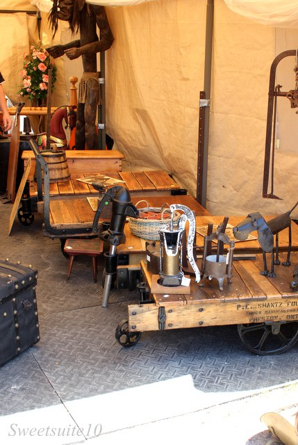 a selection of old mine carts re-purposed as coffee tables