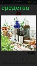 на столе стоят различные средства в бутылочках и растения