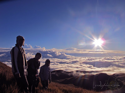 Summiteers enjoying the view at the Mt. Pulag peak