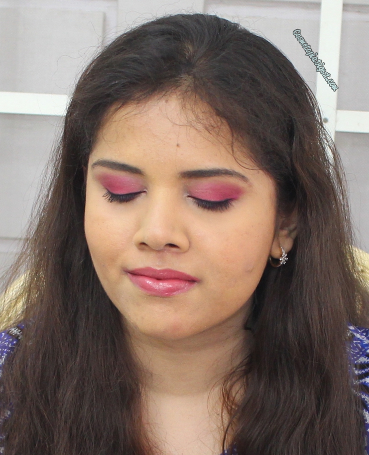A full-face makeup look featuring magenta eye makeup, using the Smashbox Art Love Color palette and Too Faced Born This Way foundation.