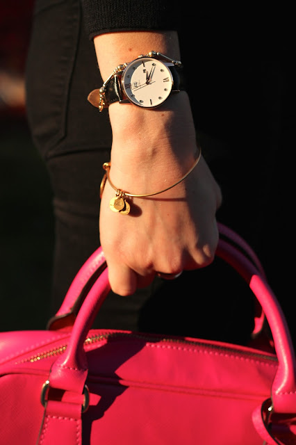 black and neon sweater, black jeans, pink flats, pink bag