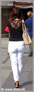 Slender lady in white jeans on the street