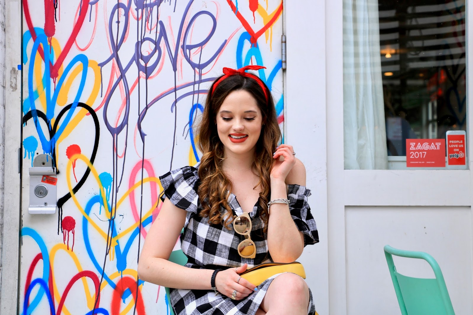 New York fashion blogger Kathleen Harper in neutral eye makeup and red matte lipstick