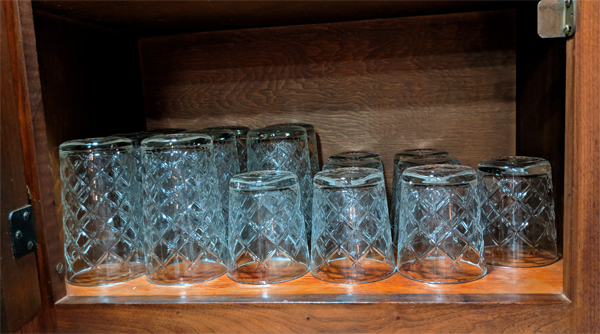 image of a set of large and a set of small Flimra glasses in my kitchen cupboard