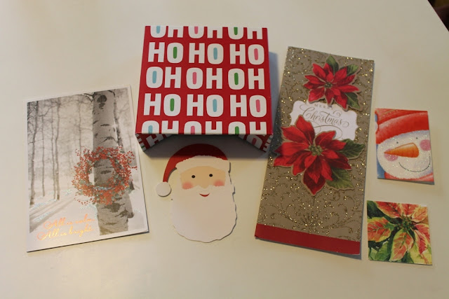 Old Christmas cards and packaging ready to be turned into new cards.
