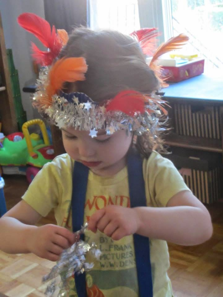 crowned toddler, feathers