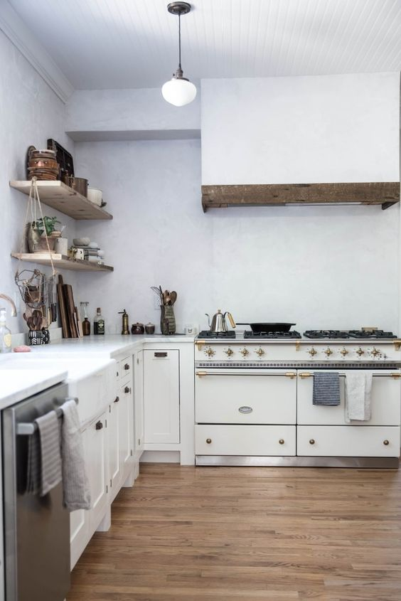 Kitchen decorating ideas from a modern farmhouse white kitchen with Lacanche Sully range. Beth Kirby of Local Milk is the homeowner and designer.#kitchendecor #whitekitchen #farmhousekitchen #modernfarmhouse #kitchendesign #lacanche #sully #venetianplaster