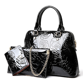 shiny black swag bag for women.