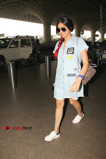 Bollywood Actress Model Adah Sharma Spotted at the Airport in a Denim Dress  0007.jpg