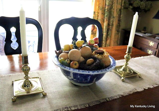brass candlesticks and blue and white bowl