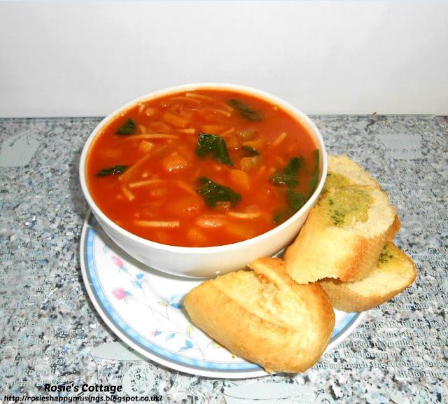 Warming winter soup with garlic bread