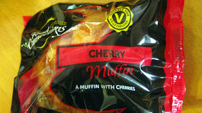 A cherry muffin in its wrapping