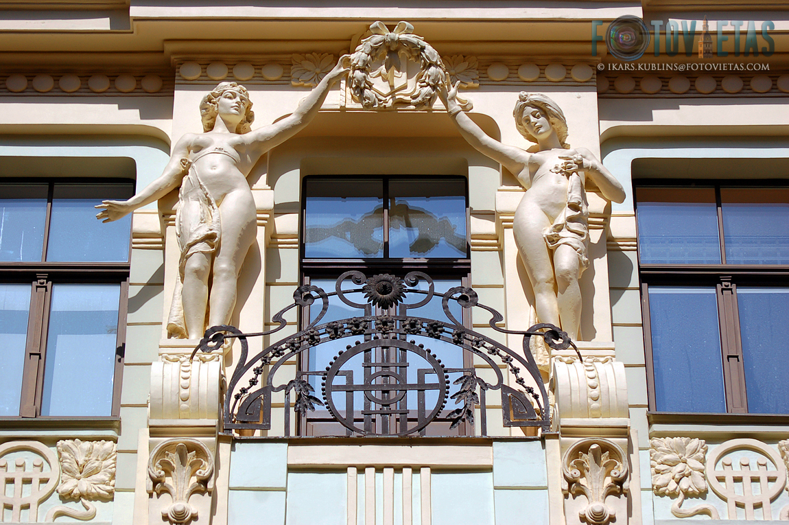 Woman sculptures on a balcony of Art Nouveau building in Riga