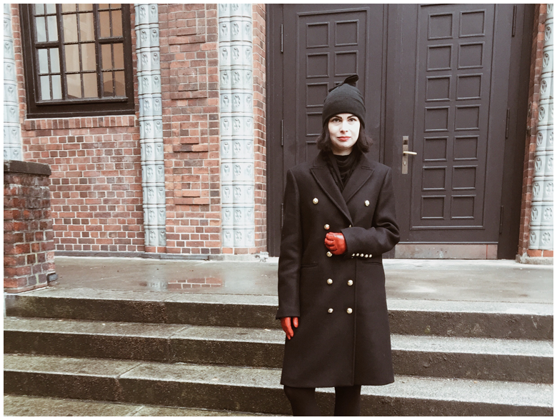 THE MILITARY COAT | June Gold wearing a black Zara military coat