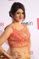 Harshika Ponnacha in orange blouuse brown skirt at Mirchi Music Awards South 2017 ~  Exclusive Celebrities Galleries 103.JPG