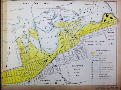 Map showing Victoria Ward (XI) in Ottawa highlighted in yellow, with drawn and named streets within the ward and some outside for context. Wellington Street extends diagonally from the bottom left (Hintonburg) to the upper right (Parliament Hill), breaking through the frame of the map. North of Scott Street and west of Parkdale is outside the City Limits, but Mechanicsville and Lemieux, Chaudiere, and Victoria Islands are painted in as part of the Ward. Rail lines snake through the ward from the bottom, left, and top of the page converging in the Bayview area and extending to LeBreton Flats in the middle of the map. From west to east, adjacent wards are noted: Elmdale (X), Dalhousie (IX), Wellington (VIII), and Central (VII).