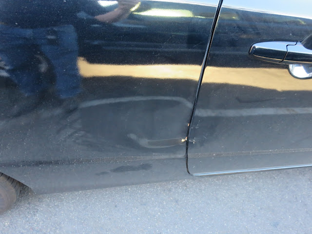Honda Civic with dented door and quarter panel before auto body repairs.