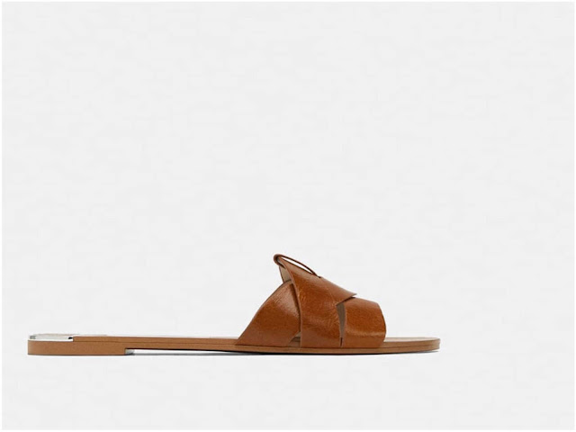 Zara's leather cross-over sandals on Island Atelier