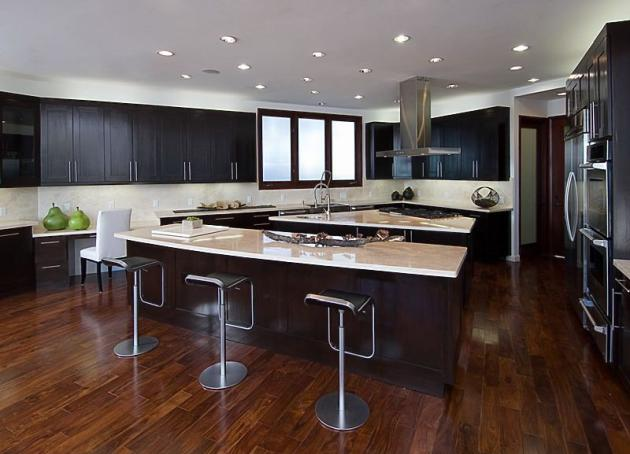 Picture of modern kitchen with brown furniture inside of Rihanna's house