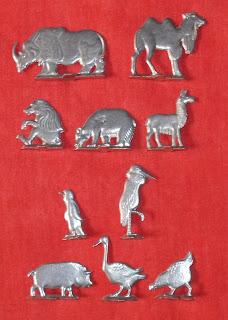 Aluminium Flats; Bactrian Camel; Bear; Camel; Chicken; Cigarette Premiums; Die Cast Toys; Farm Animals; Flat Figures; German Flats; German Toy Figurines; Goose; Llama; Mandril; Mazac; Metal Toy; Penguin; Pig; Premium Flats; Premiums; Rhino; Russian Flats; Small Scale World; smallscaleworld.blogspot.com; Stork; Wild Animals; Wild Life; Wildlife; Zamac; Zamak; Zoo Animals;