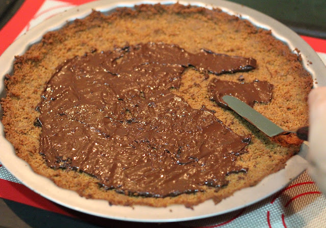... the chocolate out so it covers the base of the baked ginger tart