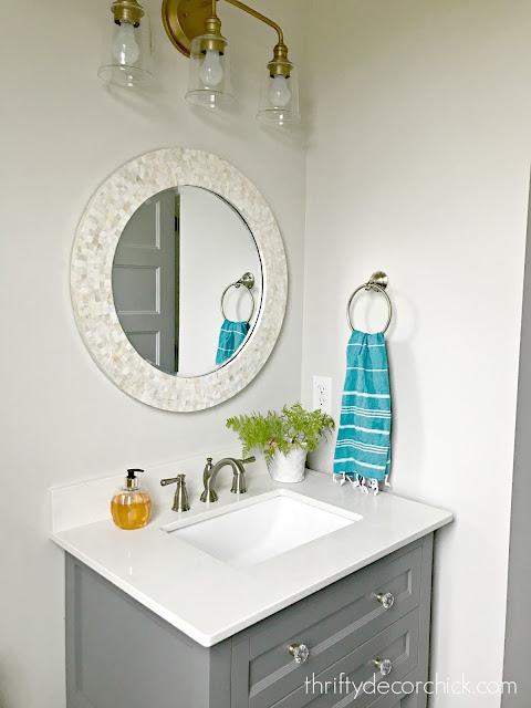 round Capiz mirror powder room