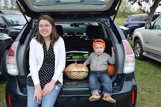 mom and toddler pumpkin patch back of a prius