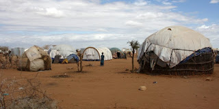 Refugee shelters in Somalia: The report says more migrants are likely. (Image Credit: DFID/UK Dept for International Development via Wikimedia Commons) Click to Enlarge.