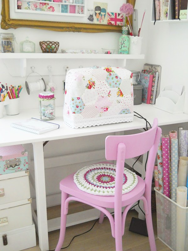 sewing space with a gorgeous pink painted chair!