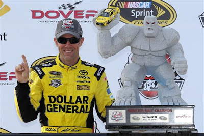 Matt Kenseth poses with the trophy in Victory Lane after winning the #NASCAR Sprint Cup Series AAA 400 Drive for Autism at Dover International Speedway