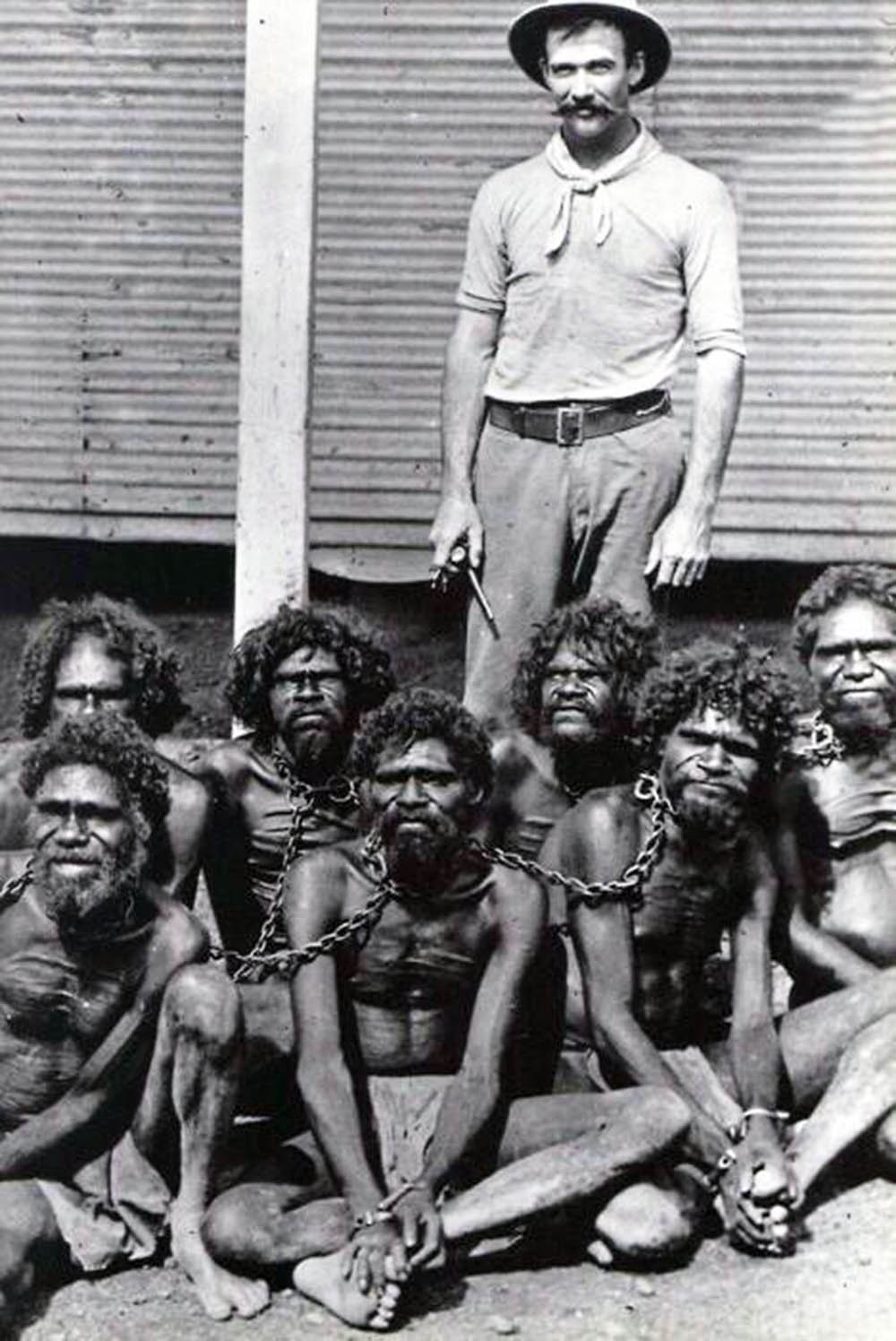 Captive and chained Aboriginals, early 1900s.