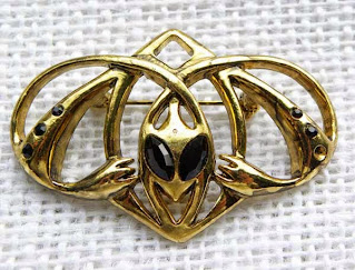 Large alien brooch in gold and black enamel