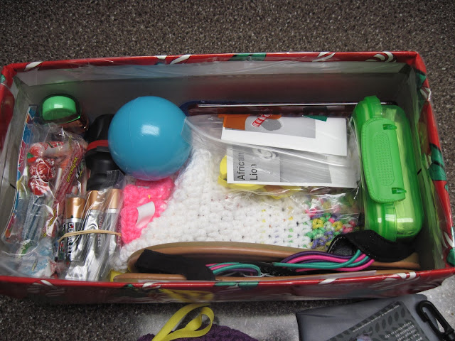Fitting lots of gifts into an OCC shoebox.