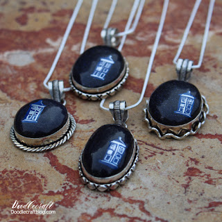 http://www.doodlecraftblog.com/2016/05/blue-sandstone-galaxy-tardis-necklace.html