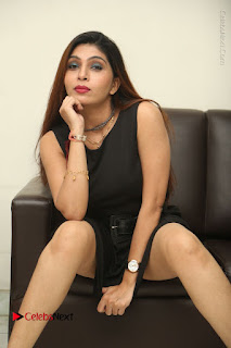 Tollywood Upcoming Actress Pooja Roshan Stills in Black Short Dress at Plus 1 Movie Trailer Launch  0280.JPG