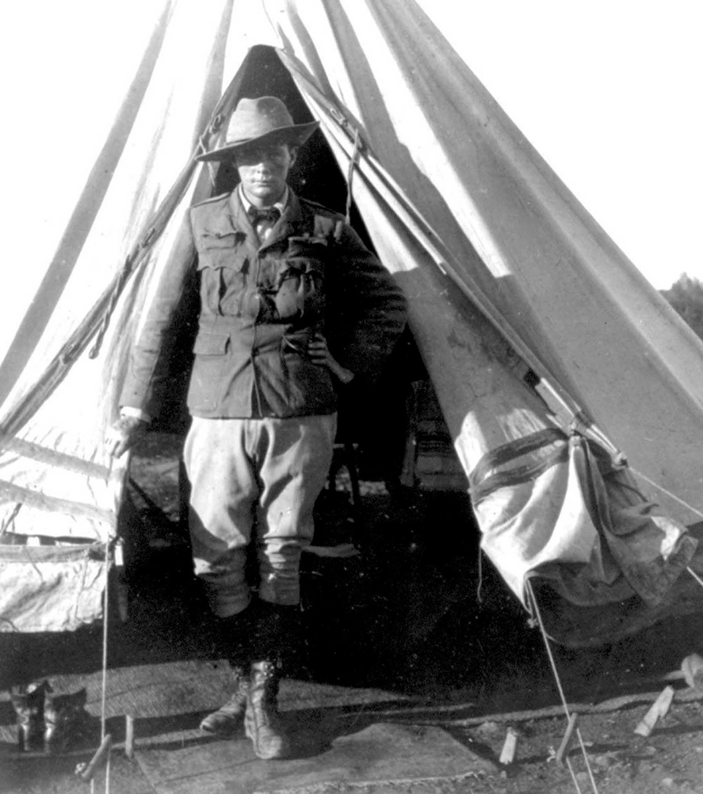 Churchill standing at the opening of his tent as a war correspondent during the Second Boer War, in Bloemfontein, South Africa.