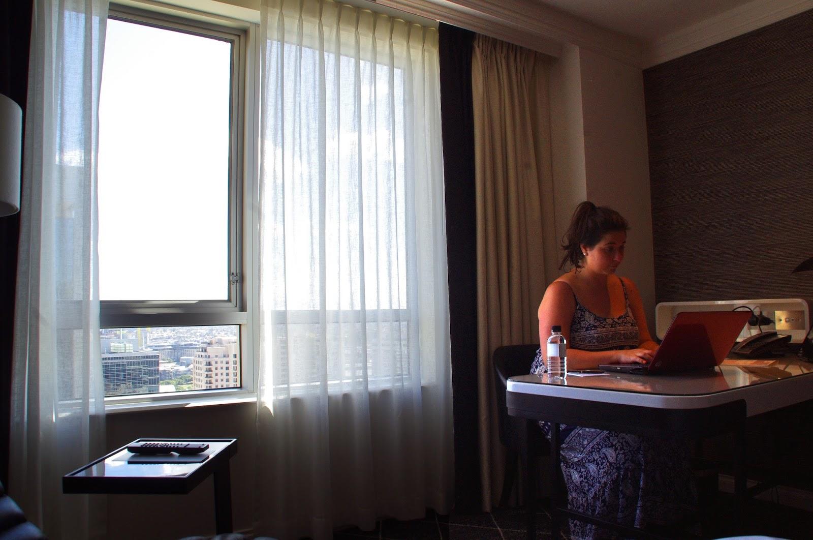 Simone working away on the blog