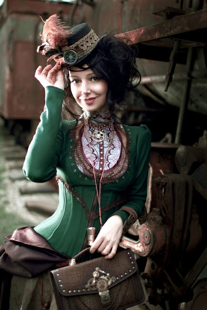 Women's steampunk cosplay, train traveler in a hat, bodice and skirt. Women's steampunk fashion inspiration.