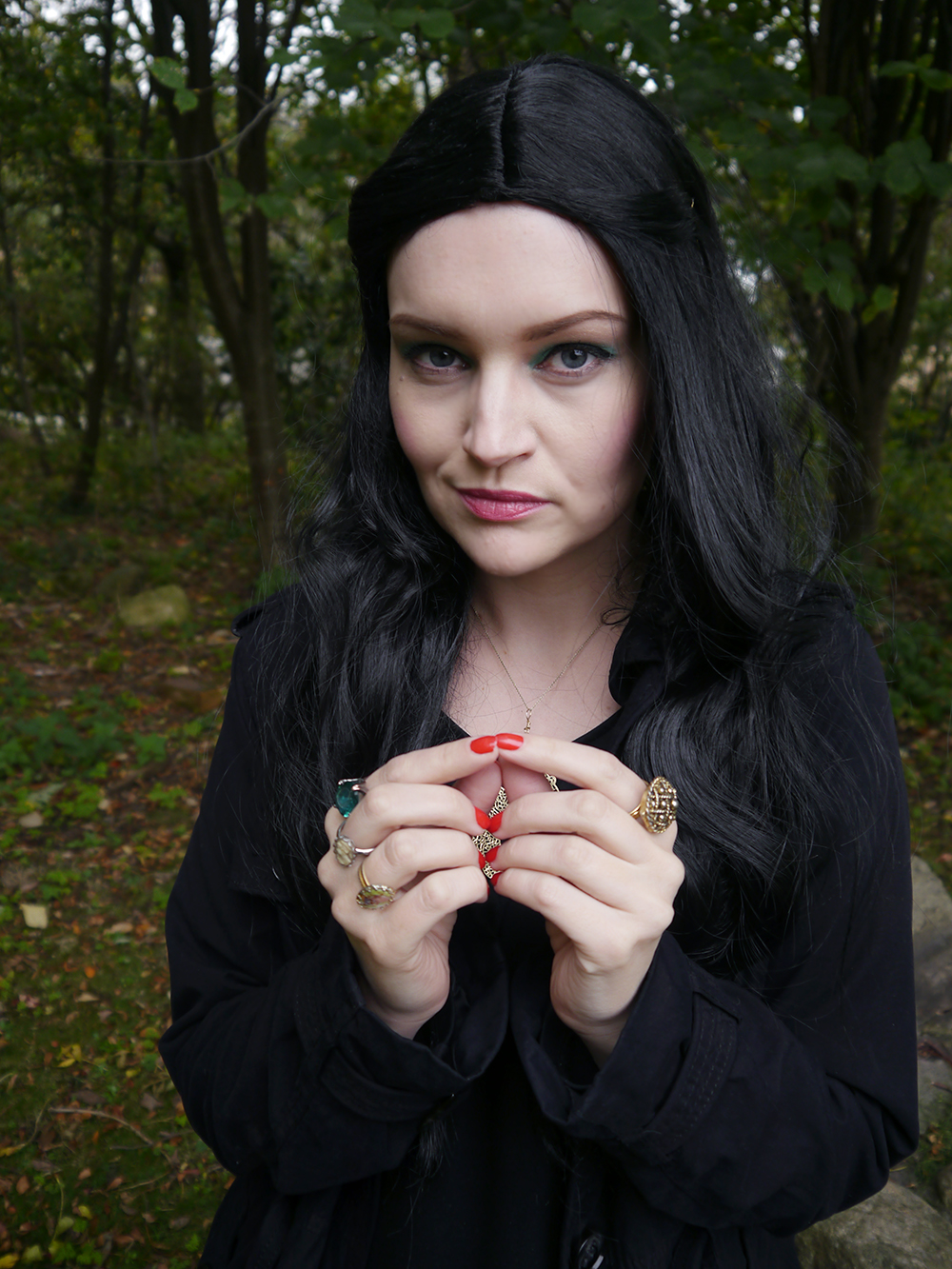 Blogger Kimberly from Wardrobe Conversations dressed in witch Halloween costume as The Love Witch with layered jewellery