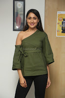 Pragya Jaiswal in a single Sleeves Off Shoulder Green Top Black Leggings promoting JJN Movie at Radio City 10.08.2017 050.JPG