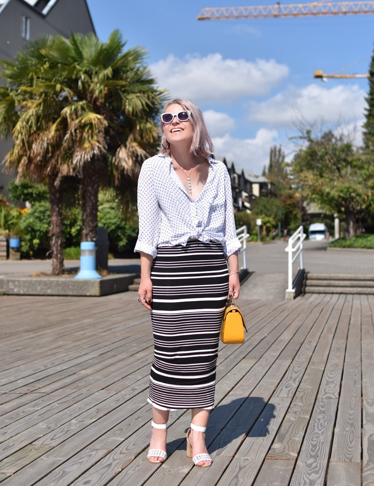 Monika Faulkner outfit inspiration - styling a striped pencil skirt with a patterned shirt and studded ankle-strap sandals