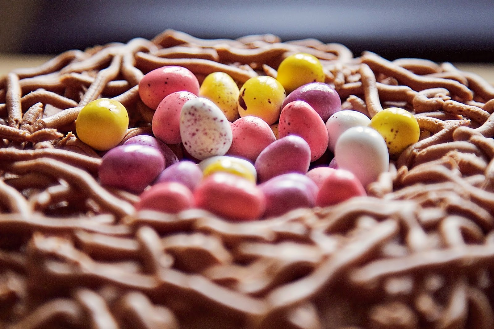 Close-Up View of the Easter nest cake with mini eggs in the centre.