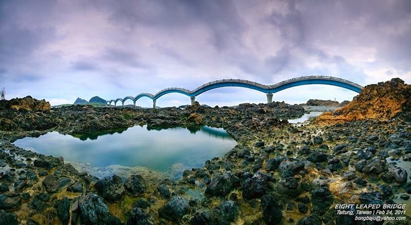 The bridge's eight arches, gently undulating, capture the rhythm of a Chinese dragon as it traverses the space between land and island.