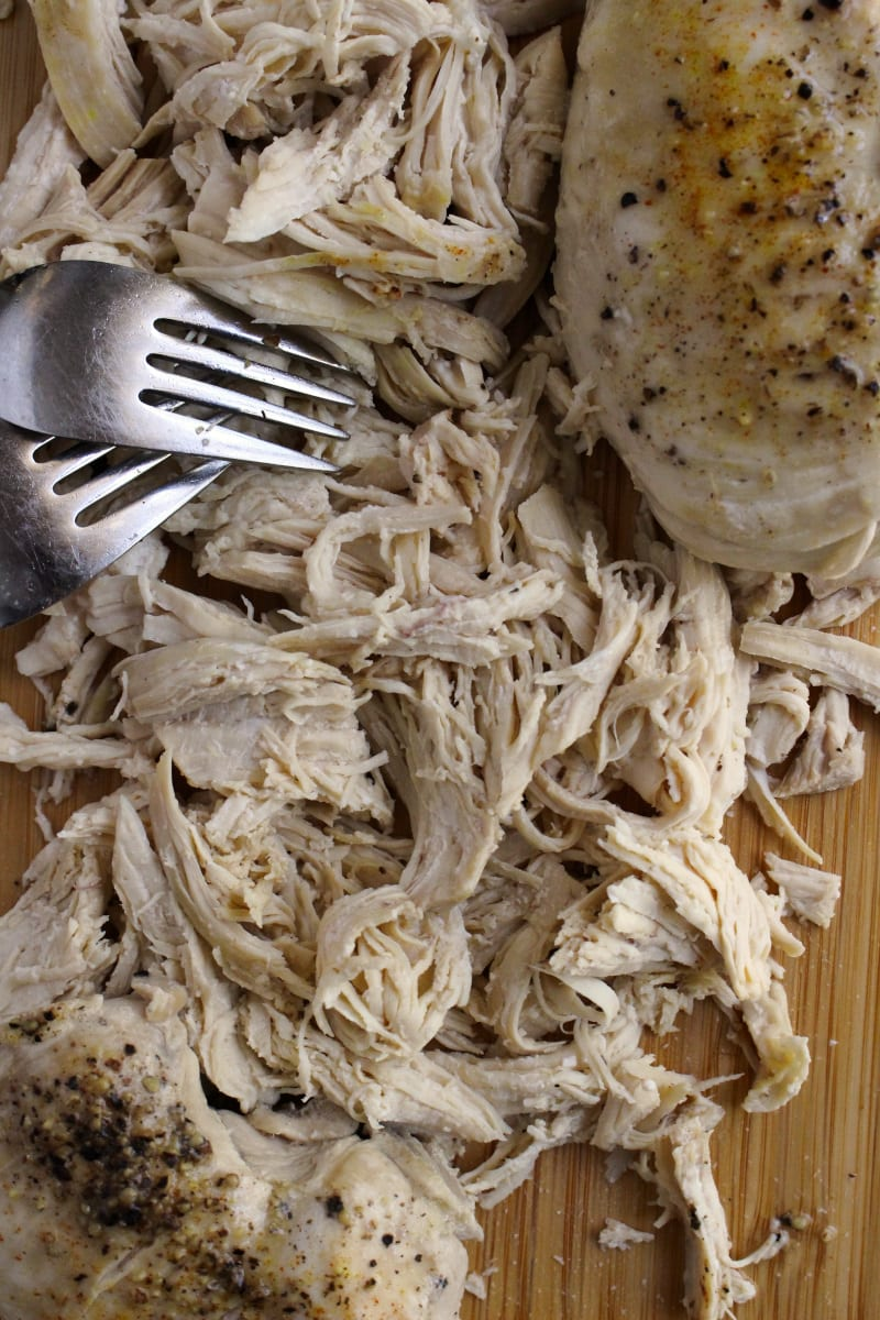This 8 Quart Instant Pot Shredded Chicken recipe makes perfectly cooked, juicy, versatile shredded chicken breasts that can be used in tons of recipes! #instantpot #chickenrecipe #mealprep