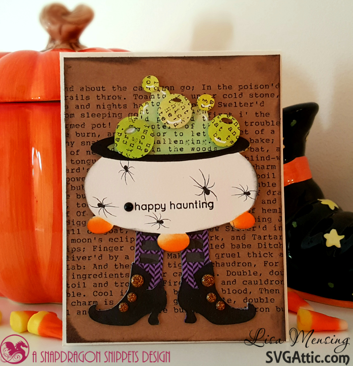 This is a Halloween card featuring a cauldron on witches legs.