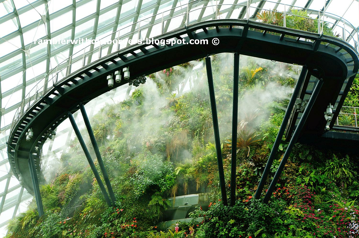 Cantilevered walkway extends out of the man-made Cloud Mountain, Cloud Forest Dome, Gardens by the Bay, Singapore